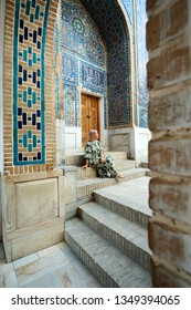 Woman Travaler on East Asia Mosque Vault Backdrop. Caucasian Female Standing in Islamic Ceramic Ornament Temple Dome. Mosaic Arch Historical Landmark. Vertical View