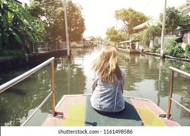 woman travel by boat at Bangkok Thailand