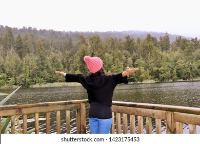 Woman travel influencer relaxing at wander trip - Wanderlust vacation concept with young adventure girl tourist wanderer on excursion in New Zealand - Warm sunshine filter