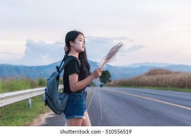 woman in with travel Lifestyle A backpacking trip on the road.