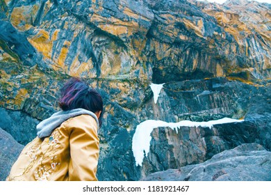 Woman travel in mountains alone. Female successful hiking climbing silhouette in mountains. Arms up outstretched on mountain top looking at inspirational landscape.