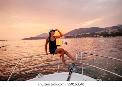 woman travel on yacht at beautiful sunset. Picturesque sunset seascape