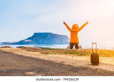 woman travel at Seongsan Ilchulbong , Jeju Island , South Korea