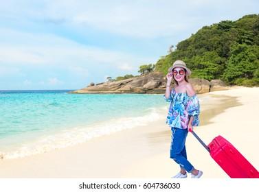 Woman to travel summer on the beach Similan, Thailand