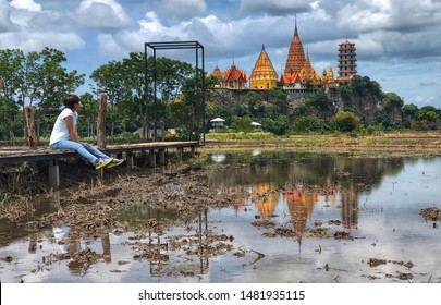 woman traveler and background of the temple (Wat Tham Sua) Thailand