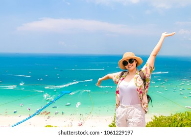 "woman traveler with backpack and hat look at the Sea beach and background from ""Koh larn"" in pattaya ,Thailand. Traveling Thailand."