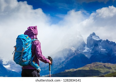 Woman Traveler with Backpack hiking in the Mountains. mountaineering sport lifestyle concept