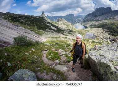Woman Traveler with Backpack hiking in Mountains with beautiful Himalaya landscape on background mountaineering sport lifestyle concept.