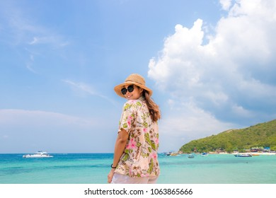 "woman traveler with bagpack and hat look at the Sea beach and background from ""Koh larn"" in pattaya ,Thailand. Traveling Thailand."