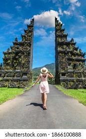 Woman traveler at  Bali Handara Gate in Bali, Indonesia in a sunny day