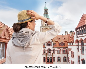 Woman traveler in hat enjoying Hannover City view