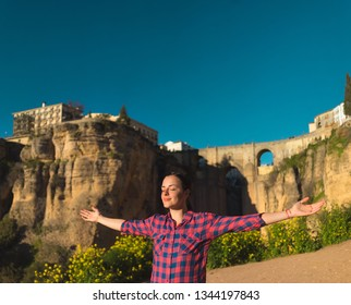 Woman traveler with her hands in the air Ronda Spain