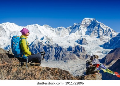Woman Traveler hiking in Himalaya mountains with mount Everest, Earth's highest mountain. Travel sport lifestyle concept