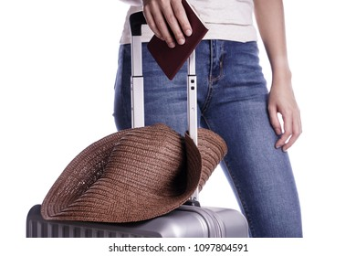 Woman traveler holding passport and suitcase. Ready for vacation travel.