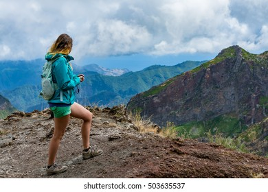 Woman traveler at Madeira mountain path between Pico Ruivo and Pico Areeiro