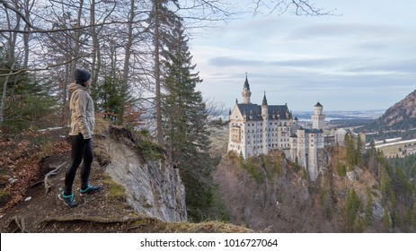 Woman traveler and the Neuschwanstein castle, Bavaria, Germany.