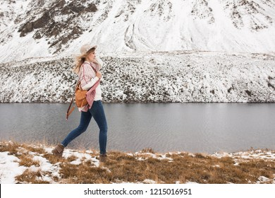 Woman traveler on the background of a beautiful mountain lake