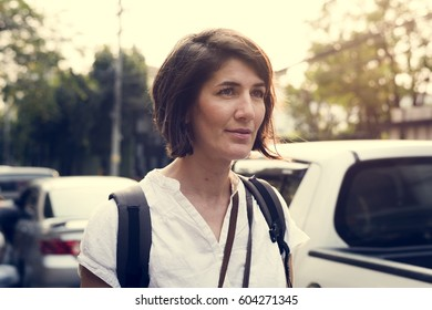 Woman traveler on street wanderlust