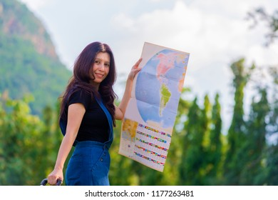 Woman traveler seeing on map with mountain view.