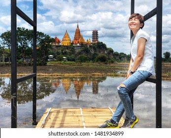 woman traveler is smiling and background of the temple (Wat Tham Sua) Thailand