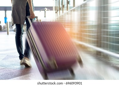 Woman traveler walking with carrying hold suitcase luggage and passenger for tour travel booking ticket flight in airport international vacation time in holiday rest and relaxation.