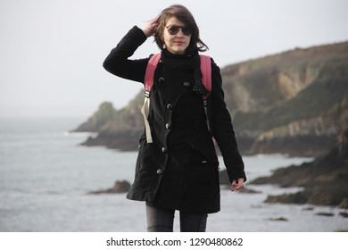 woman traveling alone in the french Brittany in winter season and having good time