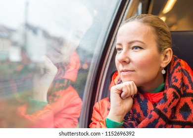 Woman traveling by train