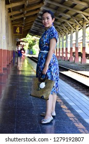 Woman with traveling on a train platform.