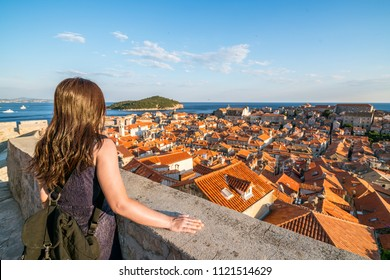 Woman traveller at Dubrovnik Old Town, in Dalmatia, Croatia - The prominent travel destination of Croatia, Dubrovnik old town was listed as UNESCO World Heritage Sites in 1979.