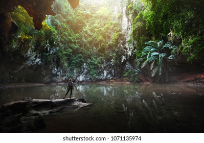 Woman traveller enjoy nature, stay at subterranean lake,Princess Lagoon,Krabi province,Thailand