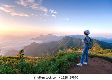 Woman traveller looking to beautiful mountain landscape at Phi Chi Fa,Chiang Rai province the north Thailand
