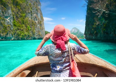 Woman travelling by boat in summer vacation among the islands Phi Phi in Thailand. Travel Asia, the concept of summer vacation.