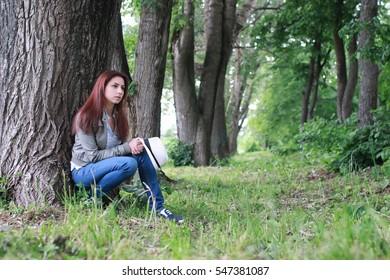 woman in tree park outdoor