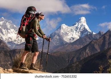 Woman trekking in high mountains, Ama Dablam peak, Nepal