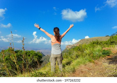Woman trekking in mountains, hiking tourist looking at beautiful view, South Africa