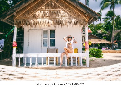 Woman tropical bungalow vacation on green background. Summer vacation. Beautiful sand beach. Tropical paradise. Exotic nature concept