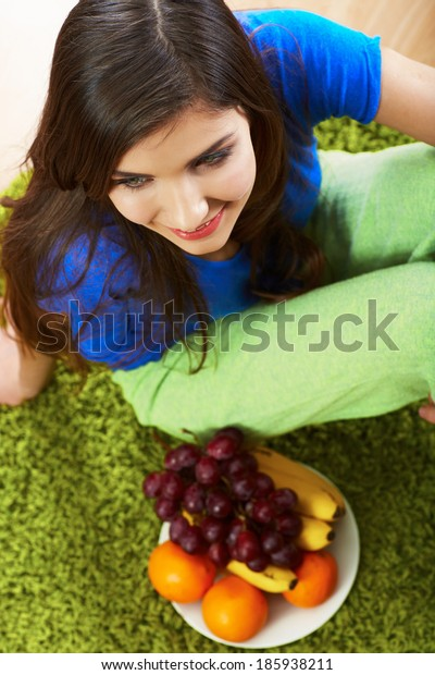 Woman tropical fruit diet. Smiling young model.