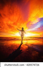 Woman at Tropical sunset on the beach. Ao-Nang. Krabi. Thailand