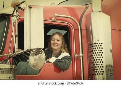 Woman truck driver leaning out the drivers side window. Retro instagram look.