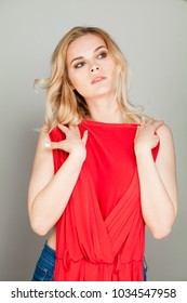 Woman try on clothes. Girl with red dress