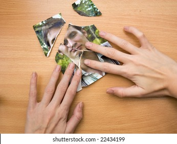 woman trying to glue together picture pieces