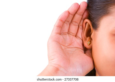 A woman trying to hearing the sound around her, taken close up to the ear and be focused around there.