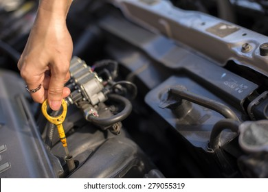 Woman trying to repair the car