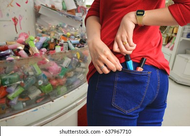 woman trying to steal items in a department store, (Pathological stealing, Kleptomania)