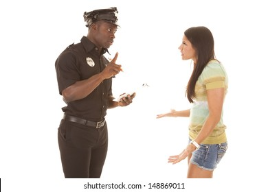A woman trying to talk her way out of a ticket, that the policeman is going to give her.