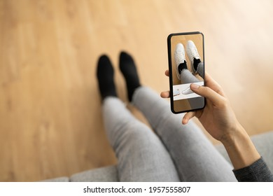 Woman Trying Virtual Sneakers In Shop Or Store AR App