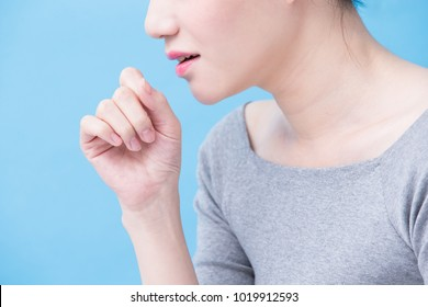 woman with tuberculosis problem on the blue background