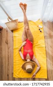 woman tuck at quarantine at home dreaming about sea beach vacation