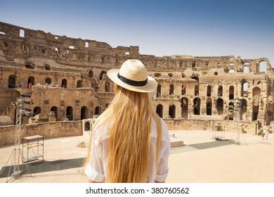 Woman in Tunisia El Jem roman apmphitheatre. Largest colosseum in in North Africa. El Jem,Tunisia. UNESCO