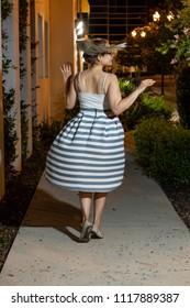 Woman twirling outside